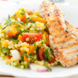 Spicy grilled chicken with fresh vegetables and co...