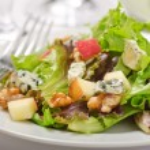 Waldorf salad with greens, apples, walnuts, and bl...