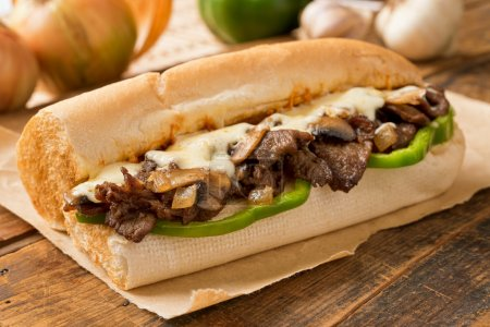 A delicious oven bake steak and cheese submarine s...