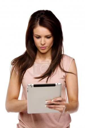 Brunette woman using a computer tablet