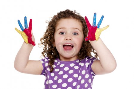 Young girl with painted fingers isolated on a white background