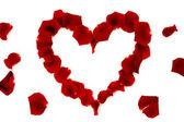 červenou růží ve tvaru srdce
