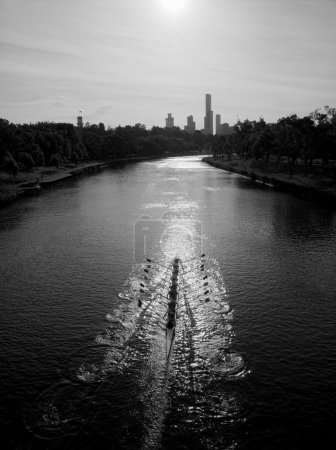 Black and white picture of a rower on the yarra river melbourne