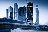 Skyscrapers of Moscow city business center.Blue toned image