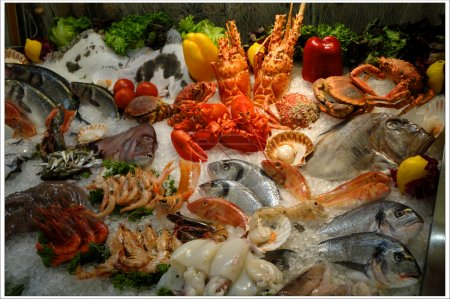 Photo for Demonstration of seafood, including fish, octopus, clams, lobster, shrimps and other products. - Royalty Free Image