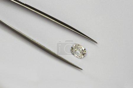 Diamond and tweezers