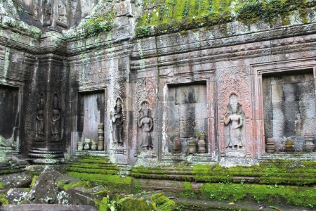 Moss-covered stone temple ruins near Angkor Wat, Siem Reap, Cambodia