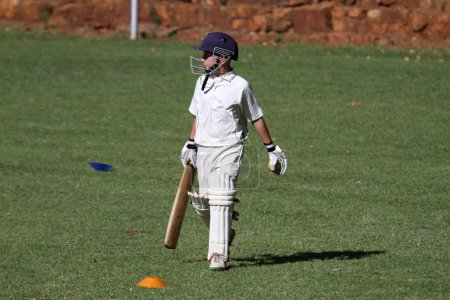 School cricket boy bat in