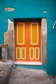 Brightly painted front door in the colourful old town of Bosa, Sardinia, Italy