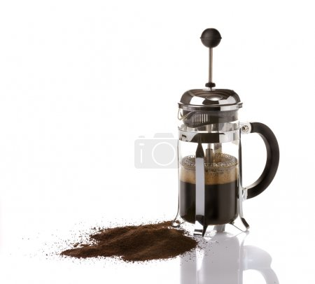 French press coffee maker on white background with...