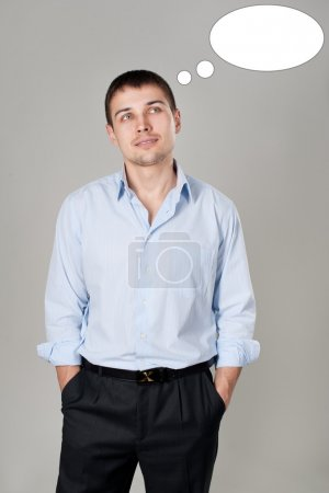 Young thinking man in the shirt