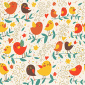 Cartoon seamless pattern in warm colors with cute birds