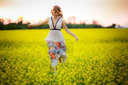 Woman in a field of wildflowers.