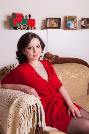 Girl sitting on a beautiful sofa