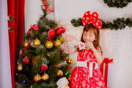 Red haired girl near Christmas tree