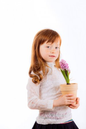 Pretty red-haired girl with hyacinth