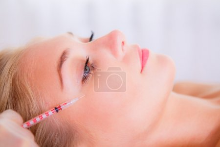 Cosmetic injection to the pretty female face