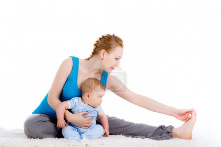 Mother with a child engaged in yoga