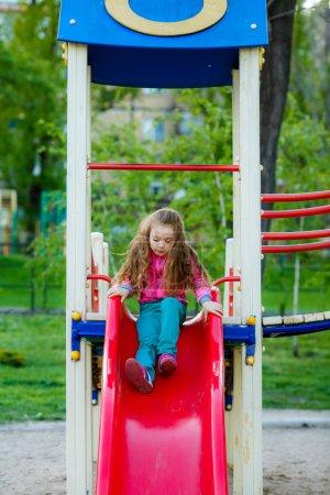 Girl on a children's slide