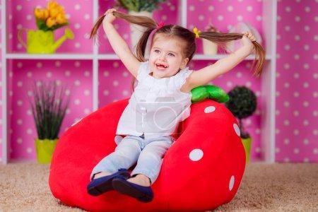 Adorable girl in the nursery.