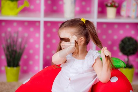 Photo for Adorable girl in the nursery. Emotions, fun, smile, children's world - Royalty Free Image