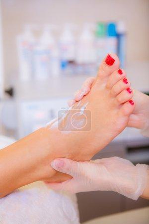 Cosmetologist making pedicure