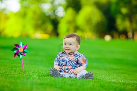 Baby playing with toy in  park.