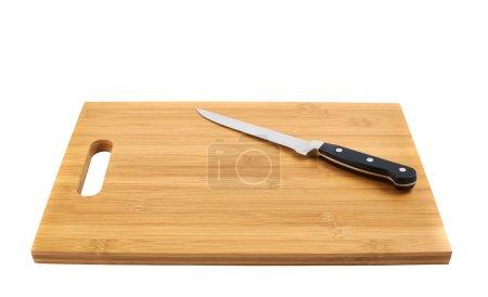 Steel kitchen knife on cutting board