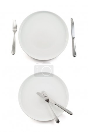 Photo for Table knife, fork and ceramic empty copyspace plate dish isolated over white background, set of two foreshortenings, before and after - Royalty Free Image
