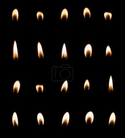 Photo pour Ensemble de flammes de bougie isolé sur fond noir, collection de vingt images - image libre de droit