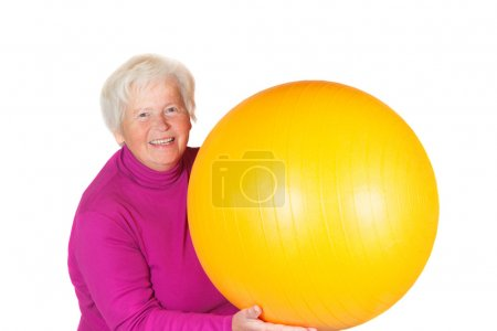 Elderly senior woman with gym ball