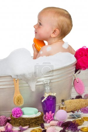 Cute little girl in a bubble bath