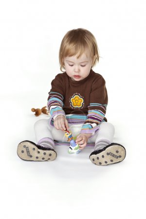 Photo for Little girl in studio playing with toys - Royalty Free Image