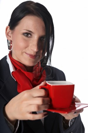 Flight attendant drinking cup of coffee