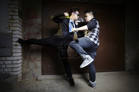 Asian men in street fight