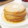Pile of delicious handmade pancakes on table...