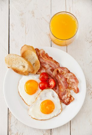 Photo for Traditional breakfast eggs with bacon - Royalty Free Image