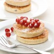 Pile of delicious handmade pancakes topped with ra...