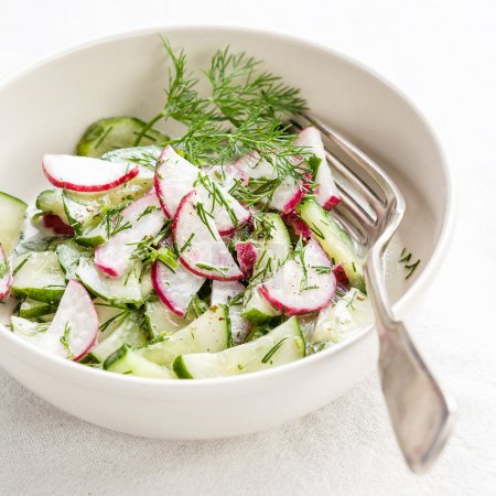 Photo for Spring salad with radishes and cucumbers - Royalty Free Image