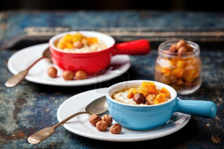 Oatmeal porridge with nuts and dried fruits