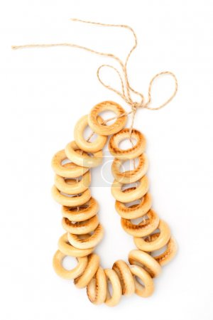 Photo for String of breadrings on white background - Royalty Free Image