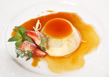 Dessert panna cotta on white plate decorated with strawbery, min