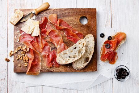 Chopping board of Cured Meat, Cheese and Olive