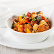 Постер, плакат: Traditional vegetable ratatouille on white plate