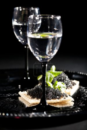 Vodka and sandwiches with black caviar