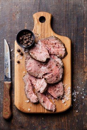 Roast beef on cutting board