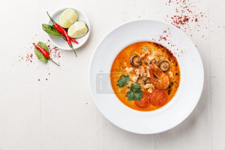 Spicy Thai soup Tom Yam with Coconut milk, Chili p...