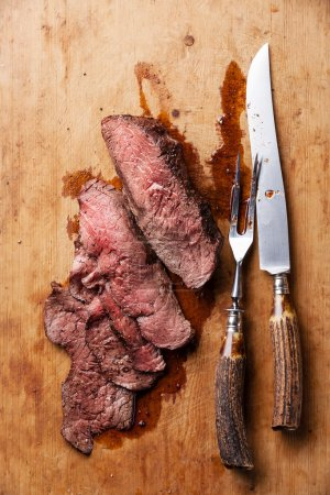 Roast beef with knife and fork
