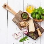 Ingredients for Preparing pesto in mortar on white...
