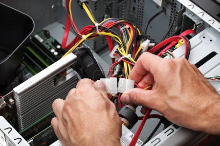 Photo for Computer engineer repairing a faulty pc - Royalty Free Image